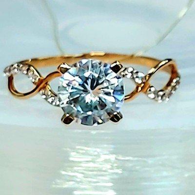 Золотое кольцо 1,22 гр.
